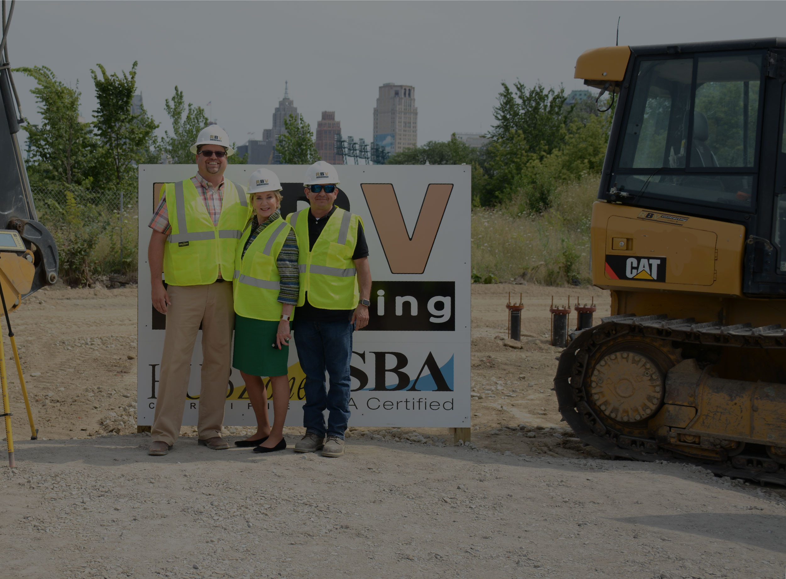 Linda McMahon poses with RBV Contracting's president, Rudy Villarrel and vice president, Jim Foucher.