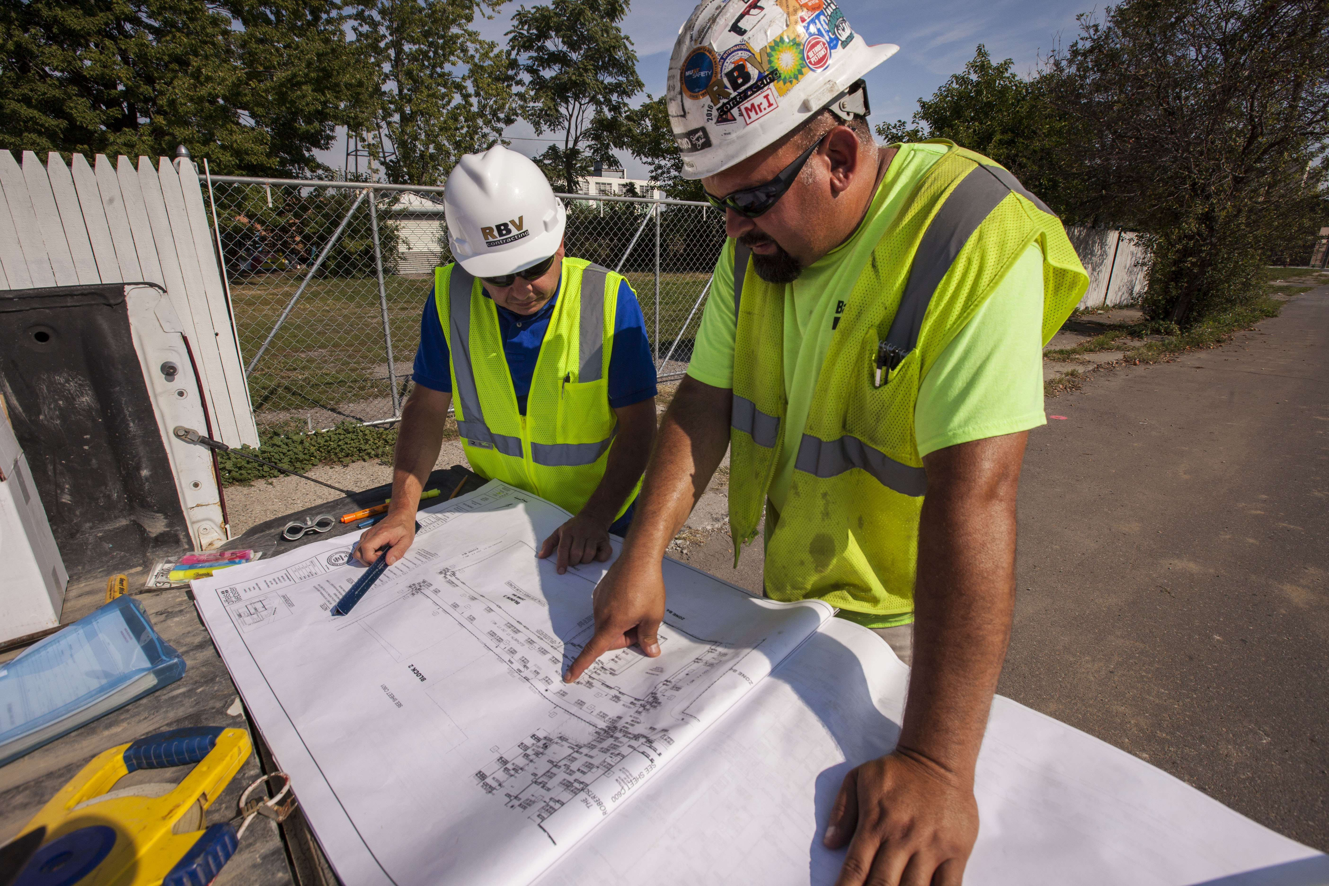 RBV Contracting employees discuss blueprints on the jobsite for Elton Park