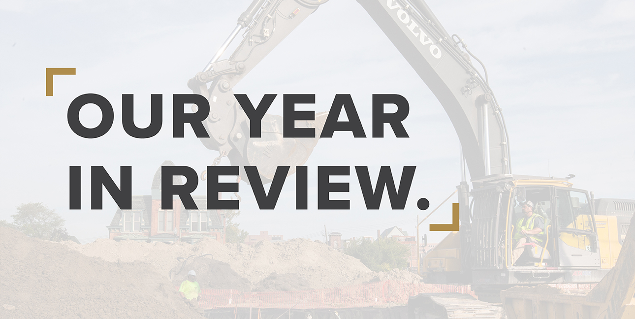 "An RBV employee works a crane while the words, ""Our year in review"" are superimposed over him"