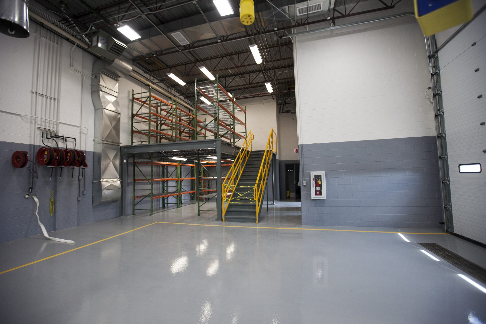 The inside of RBV Contracting's project, the 88th Armory in Southfield, shows shiny floors and multiple levels.